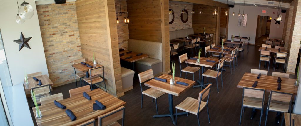 Custom Large cherry restaurant tables, original color located in Nick's restaurant by the experts at Timeworn.