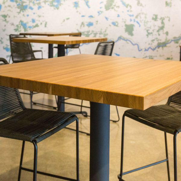 Custom tabletops for breweries, Custom Solid Oak Butcher Block original color restaurant table tops, bases and benches.